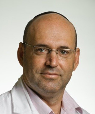 A photograph of Dror Dicker wearing a lab coat on a white background.